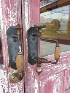 Old hand drills used as door pulls! Seen at Danna's BBQ in Branson West, Mi