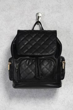 FOREVER 21+ Quilted Flap-Top Backpack A faux leather unstructured backpack featuring a quilted panel design, a flap-top with a snap-button and drawstring closure, three exterior zip pockets, a top handle, adjustable shoulder straps, one interior zip pocket, and two interior slip pockets. Afflink.