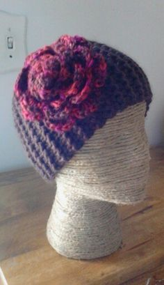 Headband, knit in Firewood yarn, with crocheted rose in red multicolored yarn, done by Jodi Villanella.