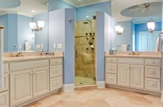 First floor master suite bathroom with double vanities flanking the shower. Designed and built by Ramage Company.