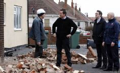 No wonder people have no confidence in politicians. It all looks so fake. Prime Minister David Cameron talks to a builder who is repairing a building that was damaged in the recent bad weather in Blackpool, Lancashire.