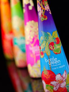 """bottlegreen. Limited edition 2009. """"Premium soft drink brand Bottlegreen is to unveil a range of stylish limited edition sparkling pressé bottles for the festive season, in stores from early November. The designs were created by textile design graduate, Rachel Pitman, following a nationwide talent search by Bottlegreen Drinks Co."""""""
