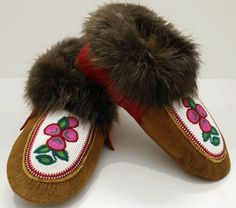 $375. Moosehide moccasin slippers with floral beaded design with red melton cuff with Beaver fur.  Made by Rosa Wedzin from Behchokö NT.