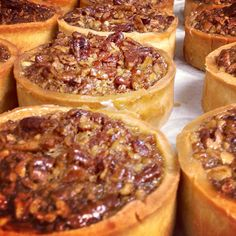Miniature Maple Bourbon Pecan Pies in the oven at Lexington Brass