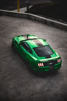 green Ford Mustang on road photo – Free Car Image on Unsplash Ford Mustang Shelby Gt500, Mustang Cars, 2015 Ford Mustang, Mustang Iphone Wallpaper, Iphone Wallpapers, Desktop, Car Top View, Shelby Car, Custom Muscle Cars