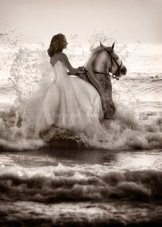 Trash the dress - in the ocean on a horse.