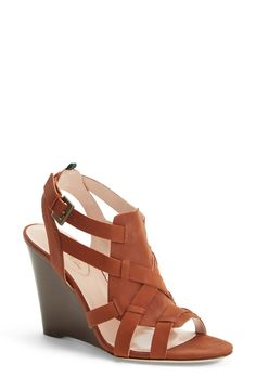 This SJP strappy wedge sandal is the perfect shoe for transitioning stylishly across seasons.