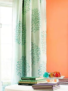 An overscale zinnia print elevates these curtains to a custom look. How to Make It: Use a stencil to apply paint directly onto the curtains.