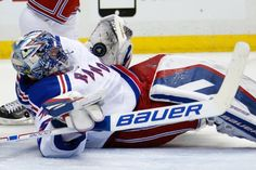 New York Rangers goalie Henrik Lundqvist (30) sprawls to make a save during the second period of a first-round NHL playoff hockey game against the Pittsburgh Penguins in Pittsburgh Monday, April 20, 2015.(AP Photo/Gene J. Puskar)