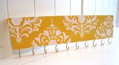 Jewelry Organizer / Hanger / Damask Pattern / Mustard & White / Hooks / Distressed. $18.00, via Etsy.