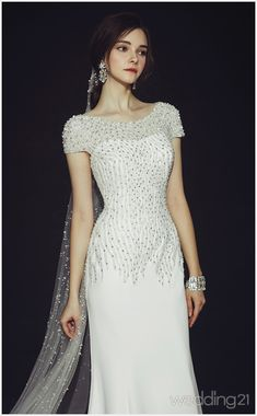 This chic wedding dress from Clara Wedding featuring cascading jewel embellishments offers a beautiful combination of timeless elegance and fashion-forward style! Chic Wedding Dresses, Elegant Wedding Dress, Bridal Dresses, Bridesmaid Dresses, Wedding Simple, Dress Wedding, Gowns Of Elegance, Timeless Elegance, Ring Verlobung