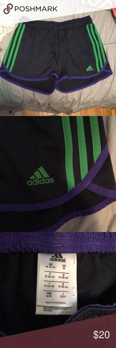 Athletic Shorts Adidas workout shorts, black, green and purple. Adjustable tie at waist, mesh material. adidas Shorts