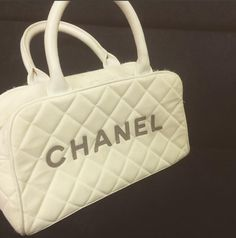 This Chanel Cc Logo White Leather Cotton Bowler Boston Satchel is a fabulous, well-designed, simple and yet exquisite and extravagant in a low profile. Visit our tradesy store for this Chanel Cotton Bowler Boston Satchel.  https://www.tradesy.com/bags/chanel-gold-gold-hardware-cc-satchel-15811657/?tref=category #Chanel #lowprofile #cotton #cc #use #preowned #lowprice #fashion #stylish