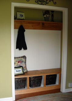 BEFORE- coat closet with bi-fold doors.  AFTER- built-in entry bench: made with reclaimed wood, bead board with shaker pegs and storage baskets