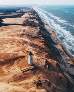First lit in 1900, Rubjerg Knude lighthouse still stands today, but is no longer lighting the way. Photo by @bokehm0n #stayandwander via @stayandwander / Instagram
