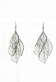 These beautifully hand crafted intricate earrings are made in black silver metal. Perfect for day out in downtown or dining out with friends. Get your shimmy on. - Handcrafted in India with love and c