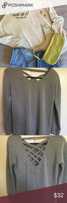 Cable & Gauge grey sweatshirt/top Cable & Gauge grey sweatshirt/top with fun, detailed, open back. Super soft and cozy! Can be dressed up or down. New with tags. Viscose, polyester, spandex blend. Cable & Gauge Tops Sweatshirts & Hoodies