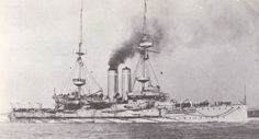"""HMS Goliath"" ca. 1907, after the addition of fire control and wireless rig.    ""HMS Goliath"" was one of the six Canopus-class pre-dreadnought battleships built by the Royal Navy in the late 19th century. Commissioned in 1900, she served in the Far East on the China Station until 1905, at which time she joined the Mediterranean Fleet.  Crew complement: 680–750.  Displacement:  12,950 long tons (13,160 t).  Length: 	390 ft (120 m); Beam: 74 ft (23 m); Draught: 	25 ft (7.6 m)."