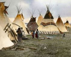 """14 Rare Color Photos Of Native Americans Taken In The 19th and 20th Centuries """"Painted Tipis of the Headmen,"""" early 1900s. Blackfeet tribe in Montana. Photo by Walter Mcclintock"""