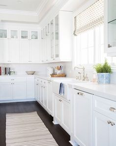 Nearing the end of @CaesarstoneUS's #TradHomeTakeover and we can't lie – we're OBSESSED with #whitekitchens! @studiomcgee shows us how to do it right by choosing dark hardwood floors and @CaesarstoneUS Calacatta Nuvo countertops for the perfect mix of depth and color.  by Tessa Neustadt  #sponsored #CSCelebratesColor  #TradHomeTakeover