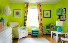 a bright colored baby room - green & blue with white accents