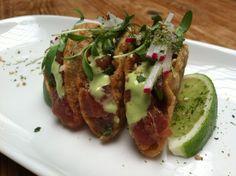 Tuna Poke Taco - tuna poke on crispy wontons topped with micro cilantro, radish and wasabi kewpie mayo to kick things up a notch.