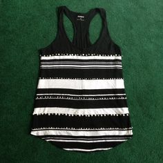 Beaded Black&White Tank Black Express tank top with white stripes and white and silver beading. Stripes and beading are only on the front side, back side is plain black. Like new, only worn a couple of times, beads are all intact. Size small but fits loose and goes great with a pair of dark skinny jeans  Express Tops Tank Tops