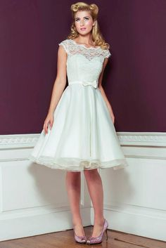 this really makes me want a second dress!   Oh My Honey White 1950s Wedding Dress lace bow details
