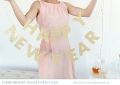 Happy New Year Bunting - Trace the letters on to glitter paper (available at scrapbooking shops), cut out with scissors, punch two small holes into each letter and string onto a piece of twine or ribbon.