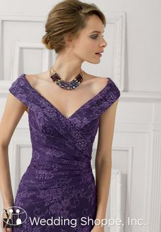 A stylish lace mother of the bride/groom dress with v-neckline.
