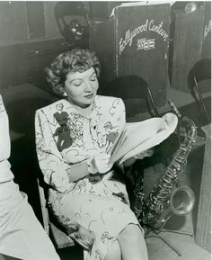 Claudette Colbert looking incredibly chic at  The Hollywood Canteen. What a dress! [pr]
