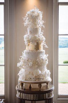 Ivory and gold luxury wedding cake by Cakes By Krishanthi. Image by Pippa MacKenzie