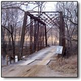 Airtight Bridge, IL - was once the sight of a gruesome murder of a woman. She was found about 50 feet from the bridge wearing nothing and missing her head, hands and feet. The murderer was never found. Since then the bridge has been awash in mysterious happenings, which includes the unusually still air that surrounds it and cars stalling mysteriously on the steep hill leading to it.