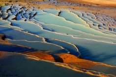 The name of this place is Badabsort and is in IRAN, an area between Kiashahr city and Semnan city(North of the IRAN). In the Spring,Summer and Autumn, water has different colors (Blue,Gray,White,Green,Orange, Brown ...). Taste and temperature of the water are different in the layers. By taking a one day tour from Tehran,you could reach this place and enjoy it... #tehran #water #travel