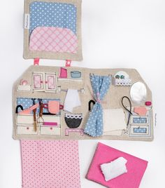 You only need a small flat surface to start playing with this miniature, portable, sewn dollhouse with several pockets and secrets. Good idea fro when travelling with kids.