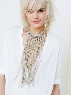 Wild Waters Fringe Necklace | Equal parts beachy and boho, this choker necklace features an exaggerated fringe bib and cowry shell accents with metal detailing. Adjustable lobster clasp closure for an effortless fit.