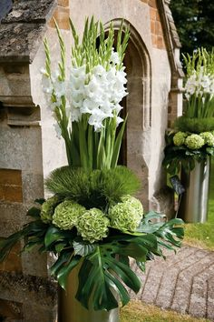 Gorgeous trunk of pure white gladiolas with a base of feather grass and green hydrangias and exotic philodendron leaves....stunning!!