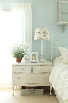 pretty blue wall and beautiful chest.  LOVE the paint color with the white!!!