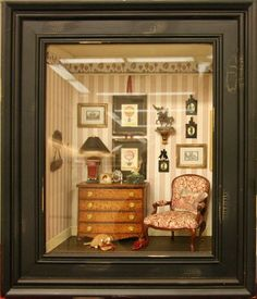 Chest of drawers with a reading lamp beside a comfortable chair in a French scene by Kristin Hill.