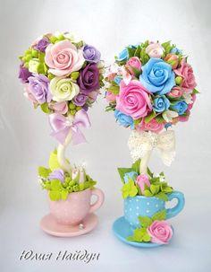 Árbol de flores dentro de una taza