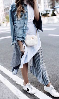 how to style a denim jacket : white top + bag + skirt + sneakers