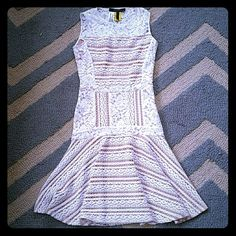 Beautiful lacey fit and flare dress JALINA DRESS lace mixed with crocheted knit over beige lining.  Cute fit and flare body adds shape to any body type.  Side zip.  BRAND NEW in excellent condition. BCBGMaxAzria Dresses