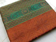 Kain tenun baron orange.  Please visit; www.sentratenunjepara.com