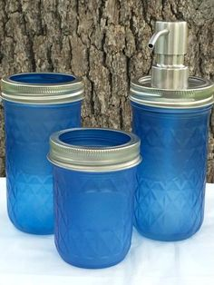 3- Piece Blue Sea Glass Mason Jar Set includes Soap Dispenser(Pint Size)>Toothbrush Holder (Pint Size)>Q-Tip Holder (Half Pint Size) Pump is Stainless Steel.