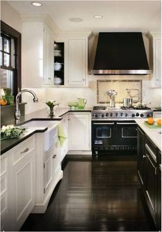 Kitchen with Black and White Cabinetry. Dark wood floors.