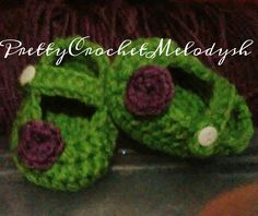 Green and purple baby shoes crochet