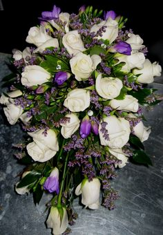 purple flowers with bling...Designed by Flowers by Antonella