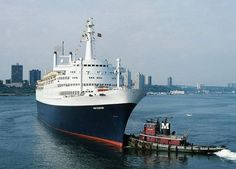 SS Rotterdam leaving New York assisted by a Moran tug.