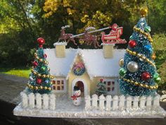 Vintage Style Putz House- picket fence, Santa on roof, snowman in front…