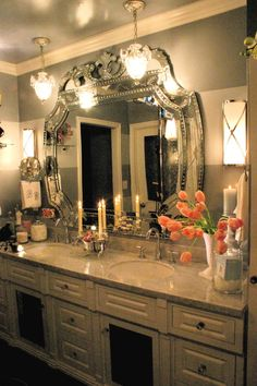 Luxurious Parisian Bathroom with exquisite Venetian mirror and crystal pendant lights